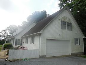 Easton vinyl siding in need of cleaning